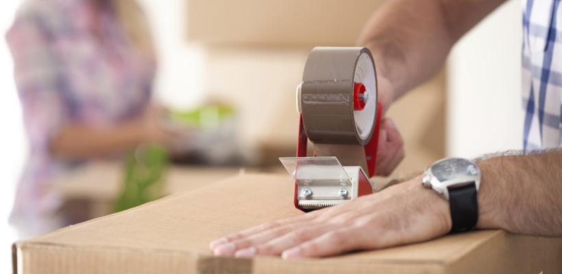 man packing a box
